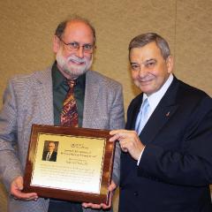 dr mootz receives-mcandrews award240